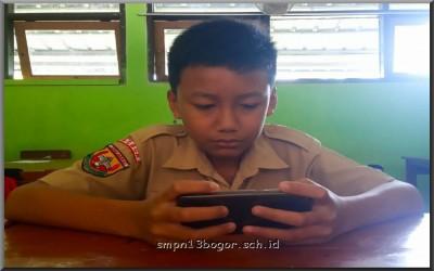 Handphone Menguasai Sekolah